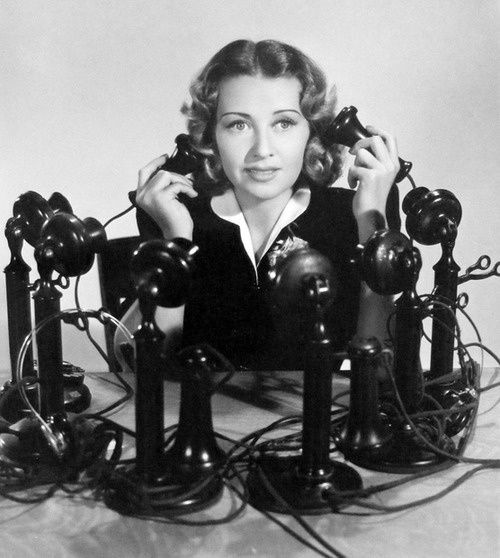 New Website woman on lots of telephones 500 x 558